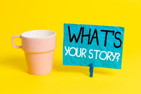 Handwriting text What S Your Story Question. Conceptual photo asking demonstrating about his past life actions career or events Cup empty paper blue clothespin rectangle shaped reminder yellow office