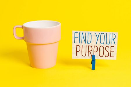 Word writing text Find Your Purpose question. Business photo showcasing reason for something is done or for which exists Cup empty paper blue clothespin rectangle shaped reminder yellow office