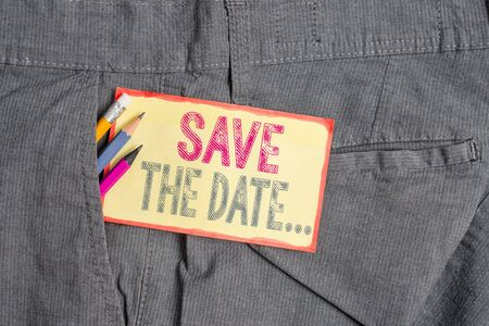 Conceptual hand writing showing Save The Date. Concept meaning Organizing events well make day special event organizers Writing equipment and yellow notepaper in pocket of trousers
