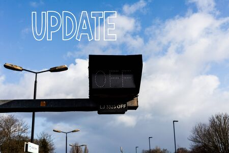 Conceptual hand writing showing UPDATE. Concept meaning make something more modern or up to date like software program Front view lamp post with two lamps sunny day sky background