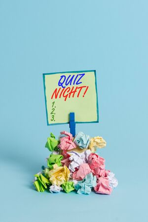 Conceptual hand writing showing Quiz Night. Concept meaning evening test knowledge competition between individuals Reminder pile colored crumpled paper clothespin wooden space