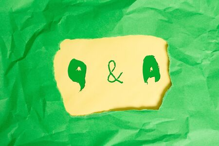 Writing note showing Q And A. Business concept for defined as questions being asked and answers Green crumpled colored paper sheet torn colorful background