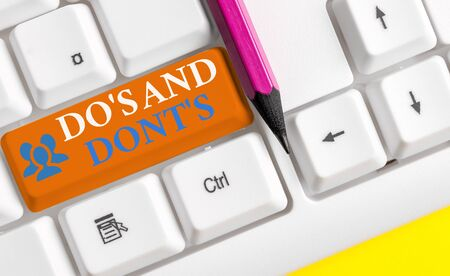 Writing note showing Do S Is And Dont S Is. Business concept for advising Rules or customs concerning some activity White pc keyboard with note paper above the white background Stock fotó