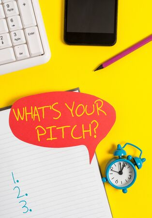 Text sign showing What S Is Your Pitch question. Business photo showcasing asking about property of sound or music tone Empty red bubble paper on the table with pc keyboard