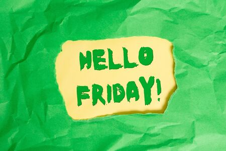 Writing note showing Hello Friday. Business concept for you say this for wishing and hoping another good lovely week Green crumpled colored paper sheet torn colorful background