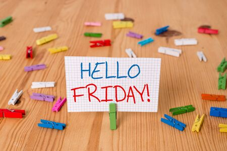 Text sign showing Hello Friday. Business photo text you say this for wishing and hoping another good lovely week Colored clothespin papers empty reminder wooden floor background office