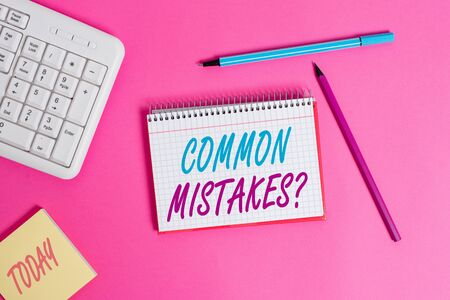 Conceptual hand writing showing Common Mistakes question. Concept meaning repeat act or judgement misguided or wrong Writing equipments and computer stuff placed on wooden table