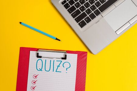 Writing note showing Quiz Question. Business concept for test of knowledge as competition between individuals or teams Trendy metallic laptop clipboard paper sheet marker colored background