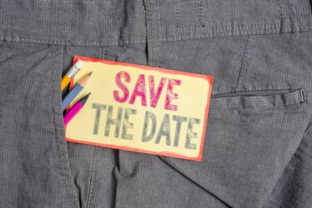 Conceptual hand writing showing Save The Date question. Concept meaning asking someone to remember specific day or time Writing equipment and yellow notepaper in pocket of trousers
