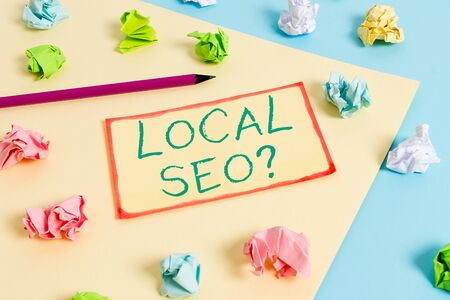 Writing note showing Local Seoquestion. Business concept for incredibly effective way to market your local business online Colored crumpled papers empty reminder blue yellow clothespin