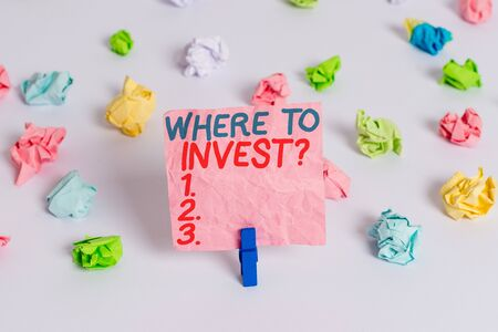 Conceptual hand writing showing Where To Invest Question. Concept meaning asking about where put money into financial schemes or shares Colored crumpled paper empty reminder white floor clothespin Stock fotó