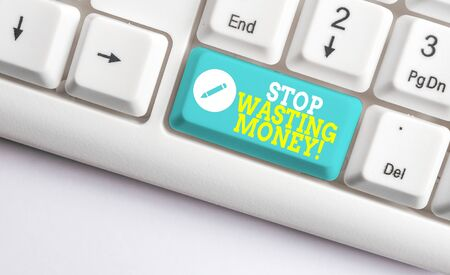 Handwriting text Stop Wasting Money. Conceptual photo advicing demonstrating or group to start saving and use it wisely White pc keyboard with empty note paper above white background key copy space