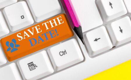 Writing note showing Save The Date. Business concept for Organizing events well make day special event organizers White pc keyboard with note paper above the white background