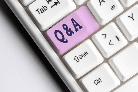 Word writing text Q And A. Business photo showcasing defined as questions being asked and answers White pc keyboard with empty note paper above white background key copy space Stock fotó - 129365516