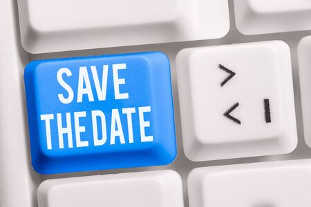 Text sign showing Save The Date question. Business photo showcasing asking someone to remember specific day or time White pc keyboard with empty note paper above white background key copy space