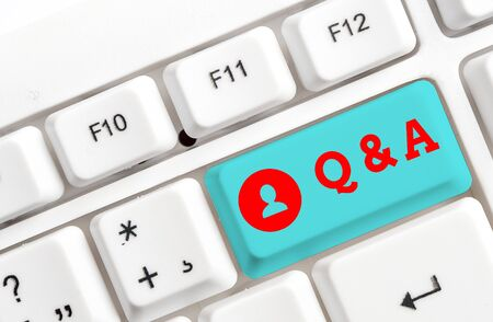 Conceptual hand writing showing Q And A. Concept meaning defined as questions being asked and answers White pc keyboard with note paper above the white background
