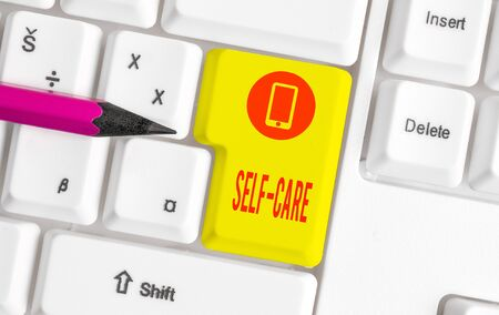 Word writing text Self Care. Business photo showcasing practice of taking action preserve or improve ones own health White pc keyboard with empty note paper above white background key copy space