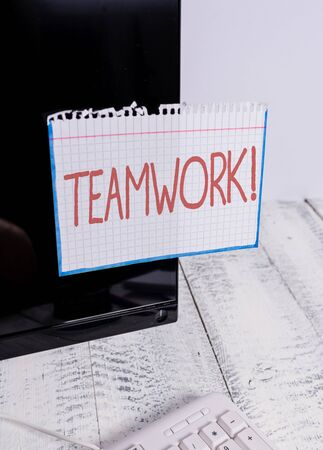 Text sign showing Teamwork. Business photo text combined action of group especially when effective and efficient Notation paper taped to black computer monitor screen near white keyboard