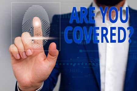 Text sign showing Are You Covered Question. Business photo showcasing asking showing if they had insurance in work or life Male human wear formal work suit presenting presentation using smart device 写真素材