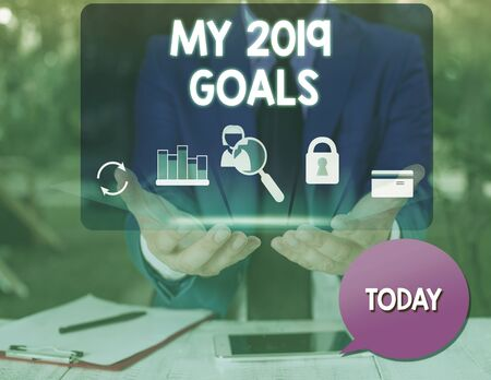 Text sign showing My 2019 Goals. Business photo text setting up demonstratingal goals or plans for the current year man icons smartphone speech bubble office supplies technological device Reklamní fotografie