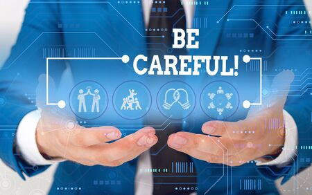 Conceptual hand writing showing Be Careful. Concept meaning making sure of avoiding potential danger mishap or harm Male wear formal suit presenting presentation smart device