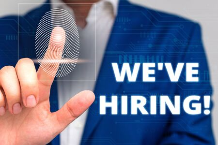 Conceptual hand writing showing We Are Hiring. Concept meaning recently you employ someone or pay someone to do particular job Male wear formal work suit presenting presentation smart device Stock fotó