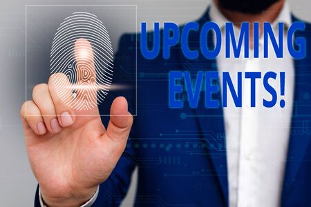 Text sign showing Upcoming Events. Business photo showcasing thing that will happens or takes place soon planned occasion Male human wear formal work suit presenting presentation using smart device Reklamní fotografie