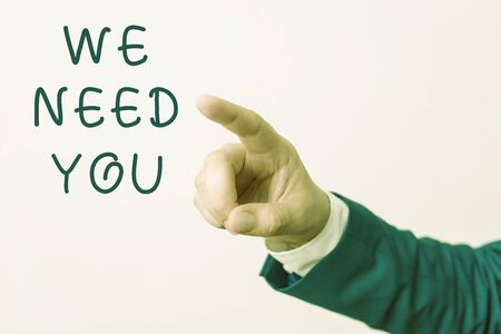 Word writing text We Need You. Business photo showcasing asking someone to work together for certain job or target Isolated hand pointing with finger. Business concept pointing finger