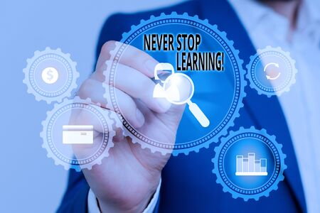 Handwriting text Never Stop Learning. Conceptual photo keep on studying gaining new knowledge or materials Male human wear formal work suit presenting presentation using smart device