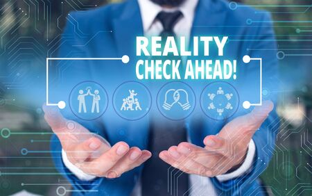 Handwriting text Reality Check Ahead. Conceptual photo makes them recognize truth about situations or difficulties Male human wear formal work suit presenting presentation using smart device Stock Photo