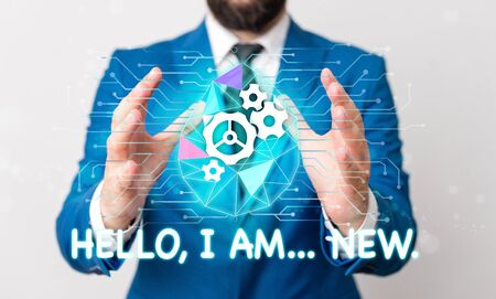 Text sign showing Hello I Am New. Business photo text introducing oneself in a group as fresh worker or student Male human wear formal work suit presenting presentation using smart device
