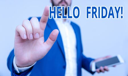 Conceptual hand writing showing Hello Friday. Concept meaning used to express happiness from beginning of fresh week Businessman pointing with pen in empty copy space