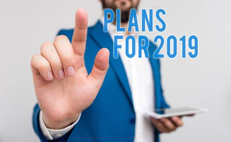 Conceptual hand writing showing Plans For 2019. Concept meaning an intention or decision about what one is going to do Businessman with pointing finger in front of him