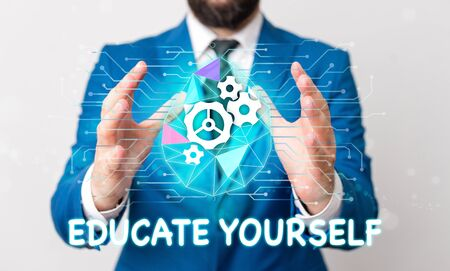Text sign showing Educate Yourself. Business photo text prepare oneself or someone in a particular area or subject Male human wear formal work suit presenting presentation using smart device 写真素材