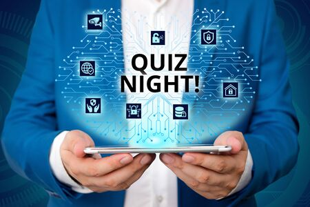 Handwriting text writing Quiz Night. Conceptual photo evening test knowledge competition between individuals Male human wear formal work suit presenting presentation using smart device 版權商用圖片