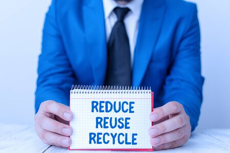 Word writing text Reduce Reuse Recycle. Business photo showcasing environmentallyresponsible consumer behavior Man holds empty paper with copy space in front of him Space 版權商用圖片