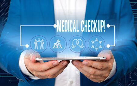 Text sign showing Medical Checkup. Business photo text thorough physical examination includes variety of tests Male human wear formal work suit presenting presentation using smart device