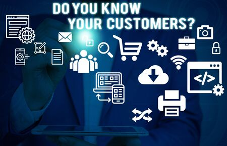 Text sign showing Do You Know Your Customers question. Business photo showcasing asking to identify a customer s is nature Male human wear formal work suit presenting presentation using smart device 写真素材