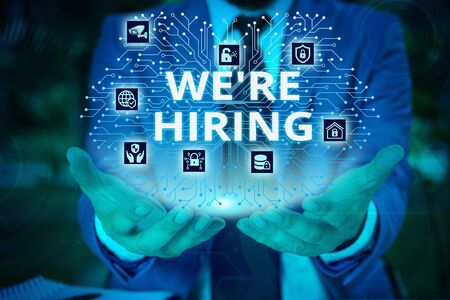 Word writing text We Re Hiring. Business photo showcasing process of reviewing applications and finding candidates Male human wear formal work suit presenting presentation using smart device