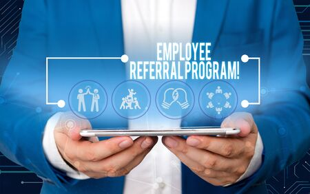 Text sign showing Employee Referral Program. Business photo text internal recruitment method employed by organizations Male human wear formal work suit presenting presentation using smart device 写真素材