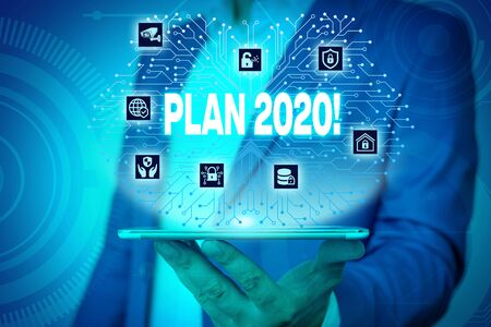 Text sign showing Plan 2020. Business photo text detailed proposal doing achieving something next year Male human wear formal work suit presenting presentation using smart device