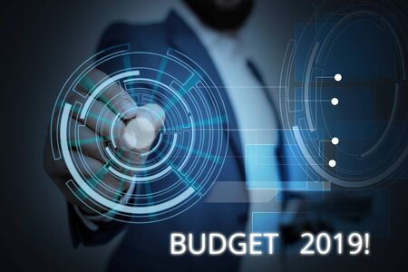 Writing note showing Budget 2019. Business concept for estimate of income and expenditure for current year Male wear formal suit presenting presentation smart device