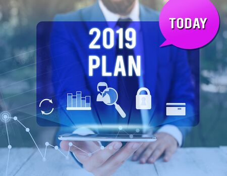 Handwriting text writing 2019 Plan. Conceptual photo setting up your goals and plans for the current year or in 2019 man icons smartphone speech bubble office supplies technological device 写真素材