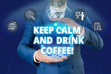 Writing note showing Keep Calm And Drink Coffee. Business concept for encourage demonstrating to enjoy caffeine drink and relax Male human wear formal work suit presenting using smart device