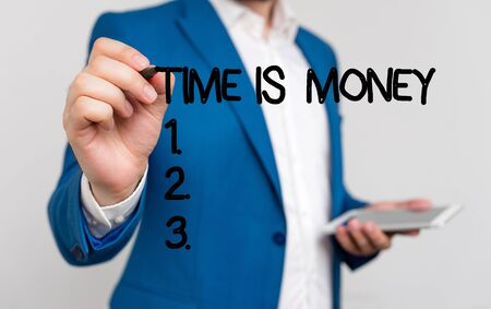 Conceptual hand writing showing Time Is Money. Concept meaning time is a valuable resource Do things as quickly as possible Businessman blue suite and white shirt pointing with finger