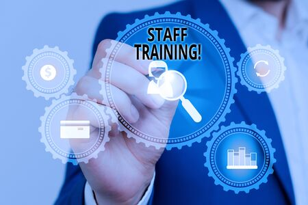 Handwriting text Staff Training. Conceptual photo learn specific knowledge improve perforanalysisce in current roles Male human wear formal work suit presenting presentation using smart device Banque d'images - 129641800