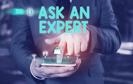 Conceptual hand writing showing Ask An Expert. Concept meaning consult someone who has skill about something or knowledgeable Male wear formal suit presenting presentation smart device