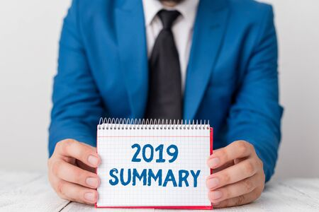 Word writing text 2019 Summary. Business photo showcasing brief comprehensive especially covering the main points of 2019 Man holds empty paper with copy space in front of him Space Stock fotó