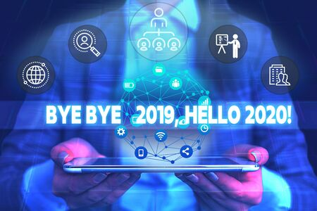 Word writing text Bye Bye 2019 Hello 2020. Business photo showcasing saying goodbye to last year and welcoming another good one Male human wear formal work suit presenting presentation using smart device