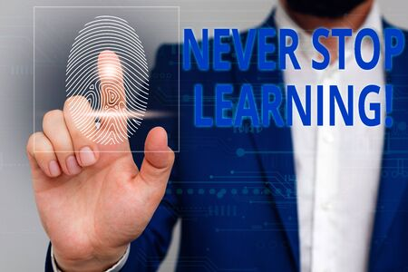 Text sign showing Never Stop Learning. Business photo showcasing keep on studying gaining new knowledge or materials Male human wear formal work suit presenting presentation using smart device Banque d'images - 129641978